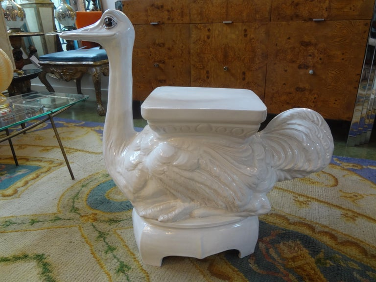 Whimsical Italian white glazed terracotta garden seat or garden stool of an ostrich. This blanc de chine garden ornament can be used indoors as a side table or end table. A versatile Italian Hollywood Regency piece that would look great in a garden