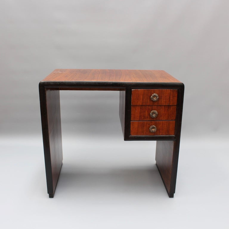 20th century Italian wooden desk, (circa 1970s). A square-edged arched shape with three drawers form the structural outline of this charming wooden desk. Originally custom-created for a small Italian village's boutique Art Deco hotel it has been