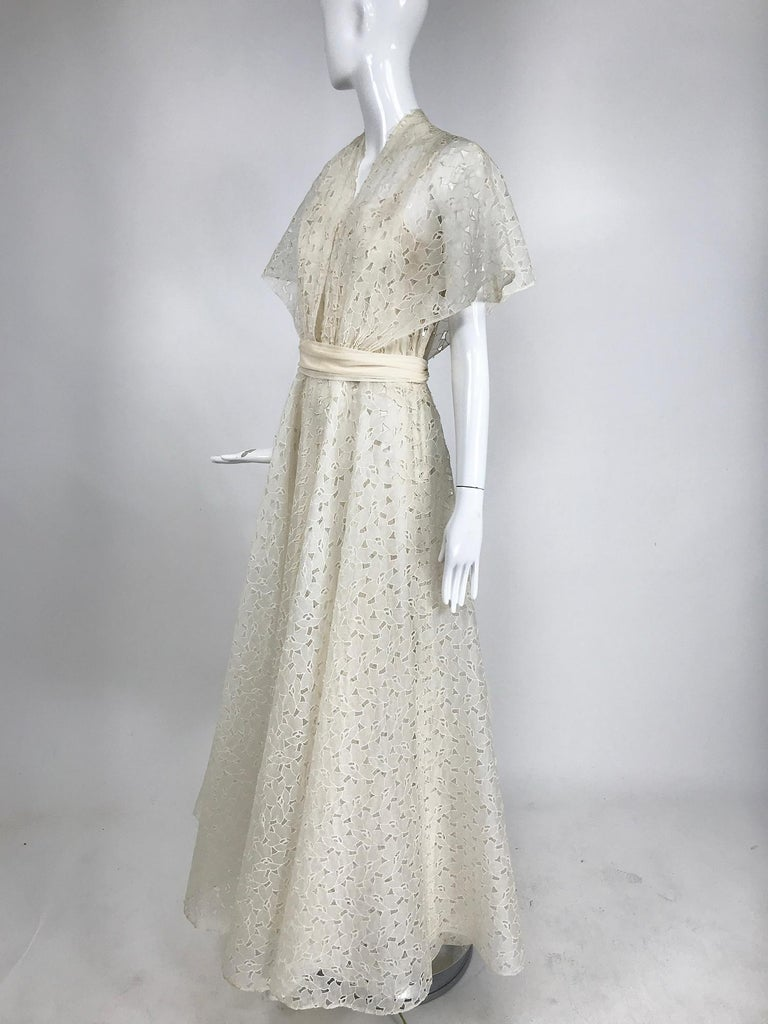 Vintage ivory cotton organza cut work summer evening party dress or wedding gown from the 1940s. It's an amazing dress and will make a fabulous special occasion even more special. Dress maker made. The fabric is fine sheer cotton which has been cut