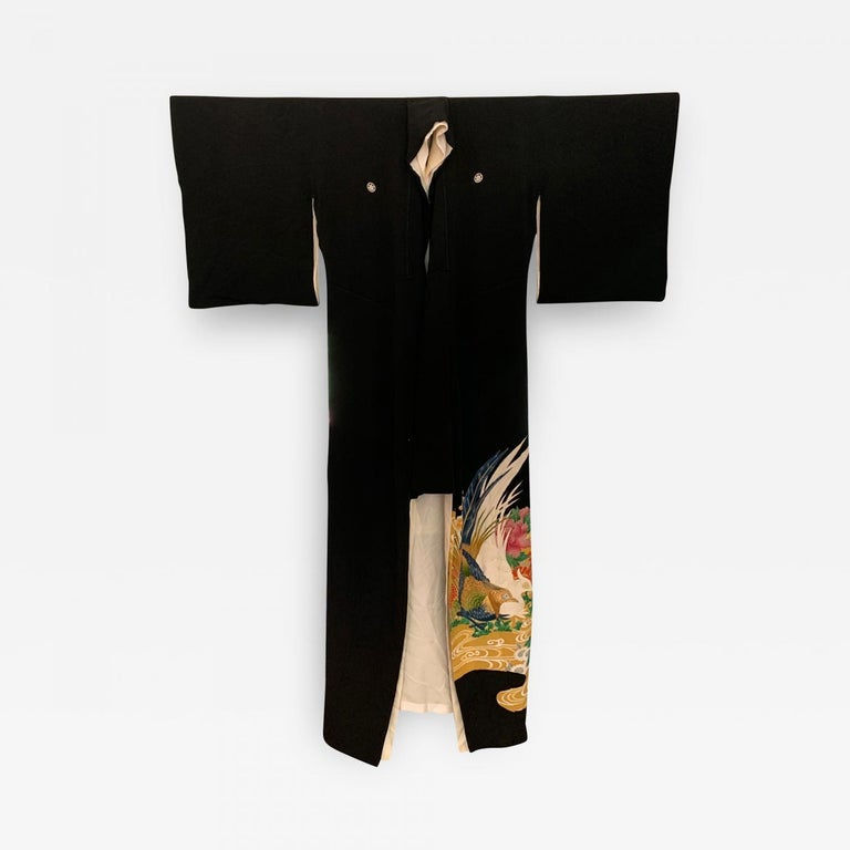 A vintage Japanese silk Kuro Tomesode Kimono, circa 1960s-1980s. Kuro Tomesode is a dress for married woman for the most formal occasions, equivalent of the evening gowns in the west. It is overall black, decorated only with patterns of bright