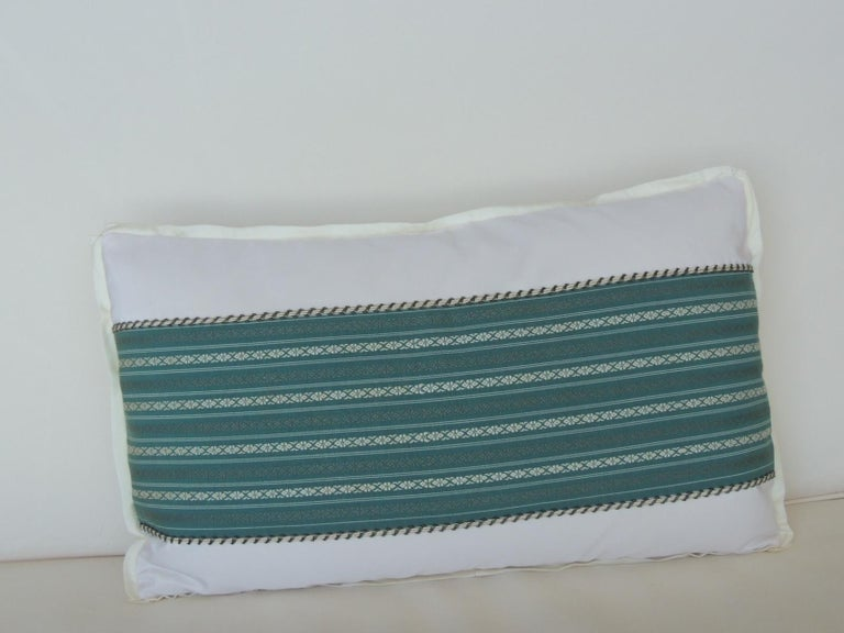 Vintage Japanese green and white obi decorative lumbar pillow with decorative trim.