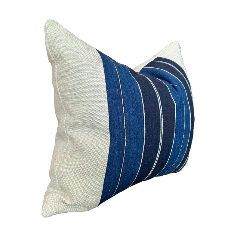 A wonderful newly-made pillow constructed from a vintage Japanese striped indigo dyed panel, backed with linen, and filled with down.