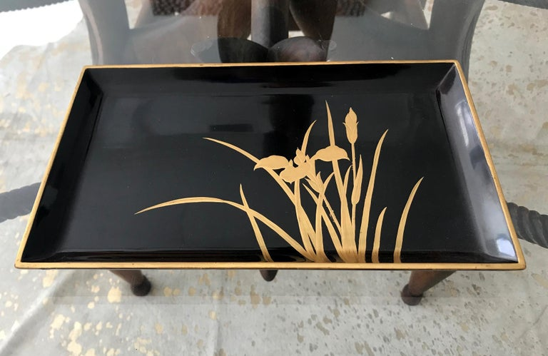 A rectangular black lacquer tray from Japan circa 1940-1960s of the Showa era. Decorated with Iris leaves and blossom and gilt trim. Medium size and very elegant in presence.