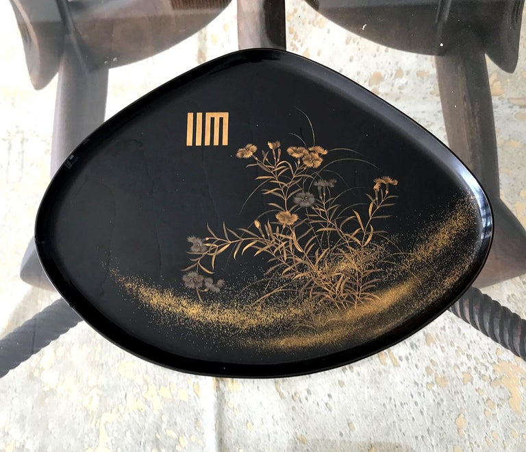 A fan shape black lacquer tray from Japan circa 1910-30s, late Meiji to early Showa era. Elaborated decorated with a bundle of yomogi blossom in a very fine Maki-e technique using both gold and silver powders. There is a Japanese symbol on the top