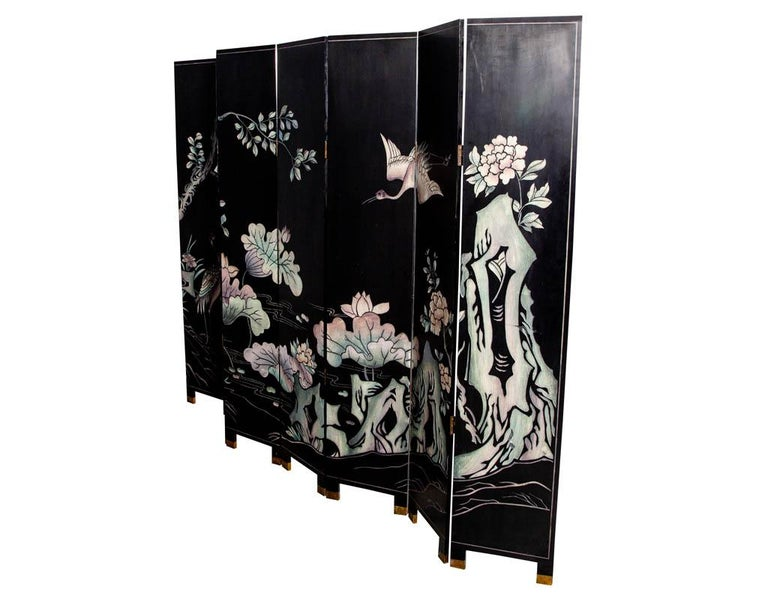 Vintage oriental screen room divider with crane, pagoda and floral hand painted motifs. Japanese cranes are among the rarest cranes in the world and are symbols of fortune, longevity, and loyalty in the Japanese culture. The screen also features a