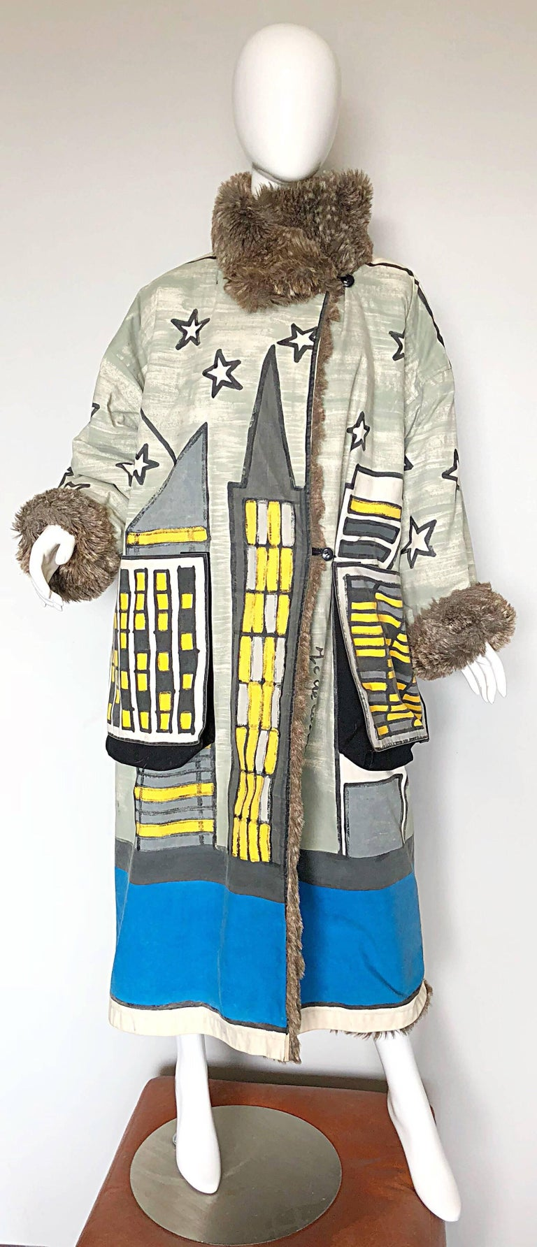 Fabulous one of a kind musuem piece vintage  JEAN CHARLES de CASTELBAJAC hand painted oversized reversible coat! Features a painted skyline with a moon, stars and UFO. Vibrant colors of blue, yellow, grey and white. Lining is a super soft gray faux