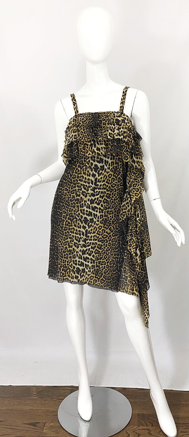 Amazing 1990s JEAN PAUL GAULTIER leopard / cheetah animal print signature sleeveless mesh dress! Features the classic print with a little edge. Ruffle sash at the down the left seam. Simply slips over the head and stretches to fit. Great with heels,