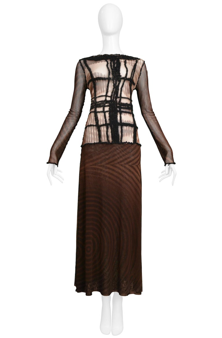 Vintage Jean Paul Gaultier brown long-sleeved mesh dress with a print of a face on the torso, dropped waist, and yarn detailing on front torso.  Excellent Vintage Condition.  Size: Medium  Measurements: Bust 30