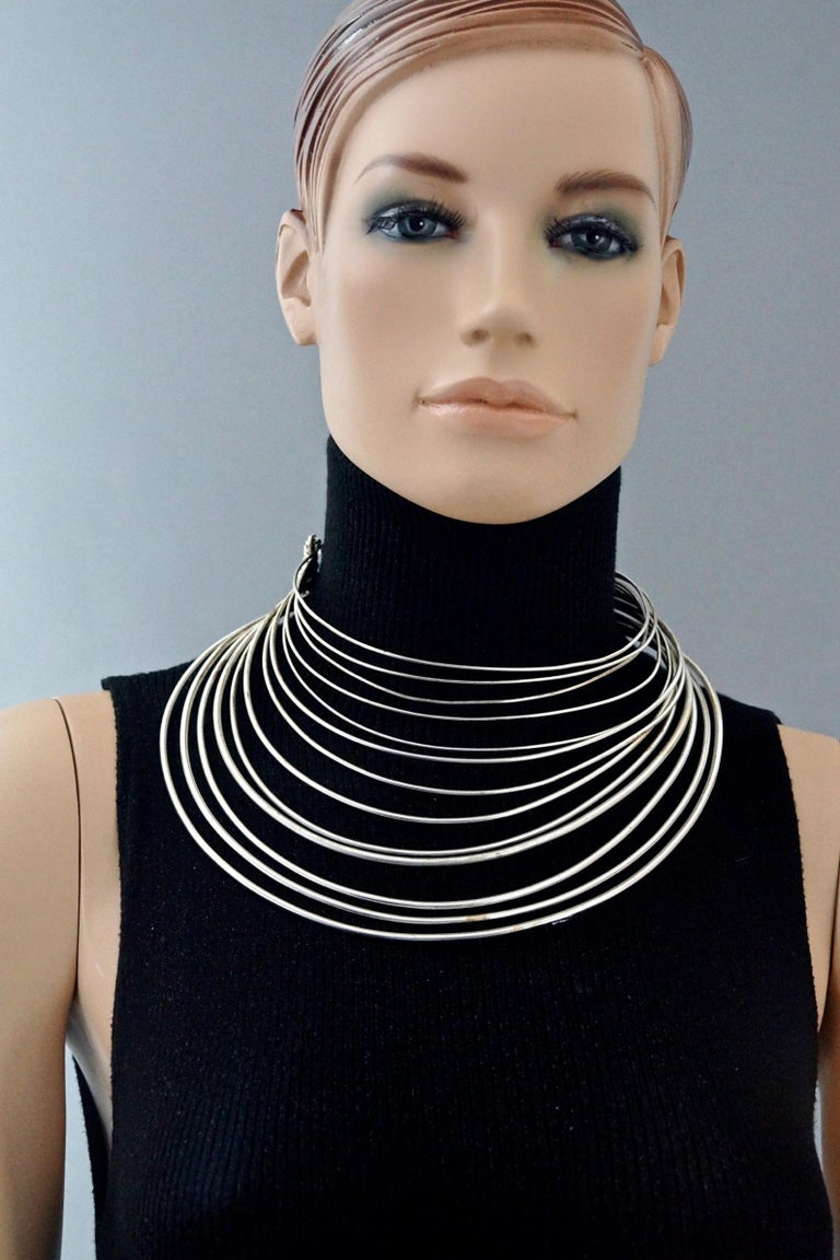 Vintage JEAN PAUL GAULTIER Masai Multi Wire Silver Choker Necklace  Measurements: Total Wearable Circumference: 15.74 inches (40 cm) Opening: 4.13 inches (10.5 cm)  Features: - 100% Authentic JEAN PAUL GAULTIER. - Multiple layer of rigid wires. -