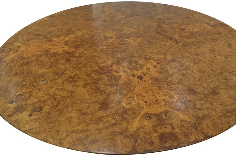 Vintage Josef Frank for Svenskt Tenn table with walnut legs and richly patterned amboyna burl wood top. The table features a pedestal base with three feet that support the table in a stable, functional manner. Unique table height, perfect for side