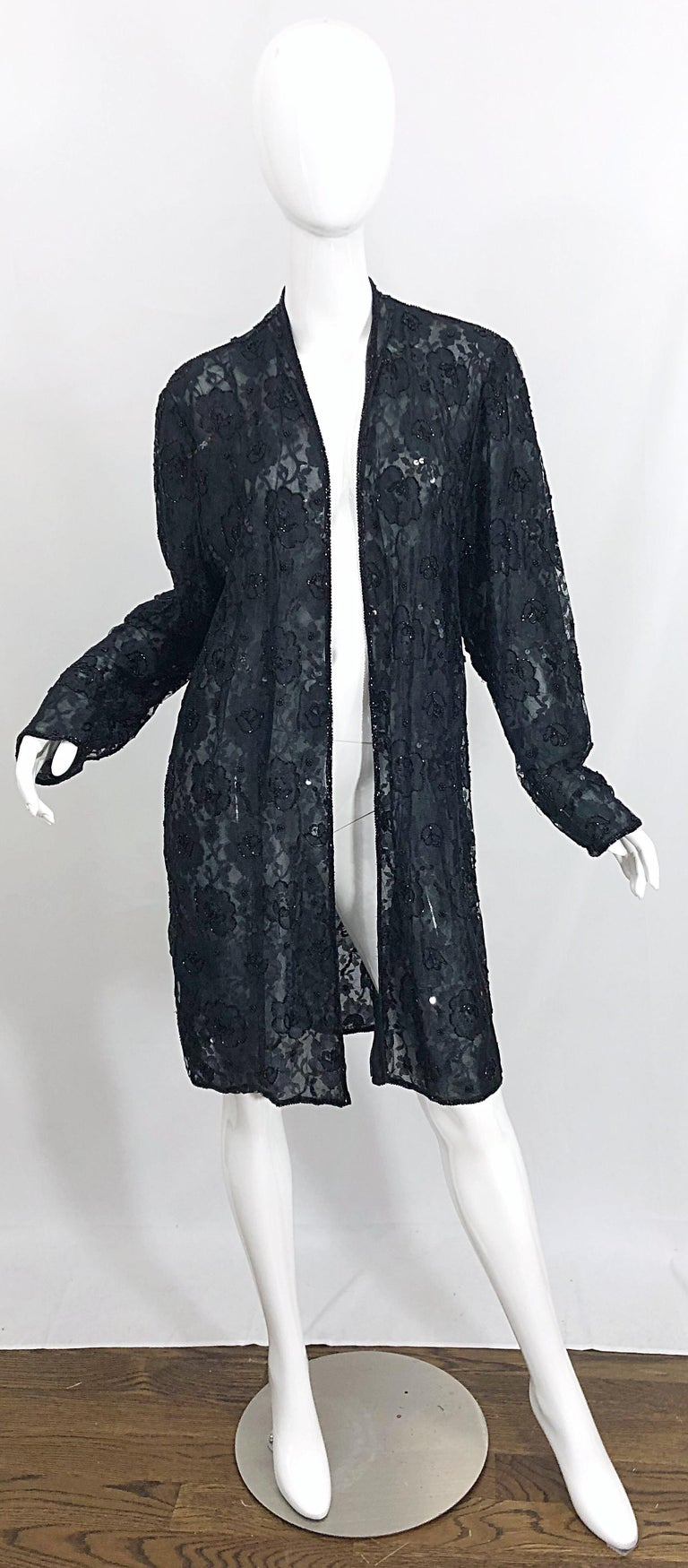 The perfect finishing piece! Beautiful vintage JUDITH ANN black rayon lace beaded sheer duster jacket / cardigan! Features a double-ply black sheer lace. Thousands of hand-sewn beads throughout. Great layering piece that can easily be dressed up or