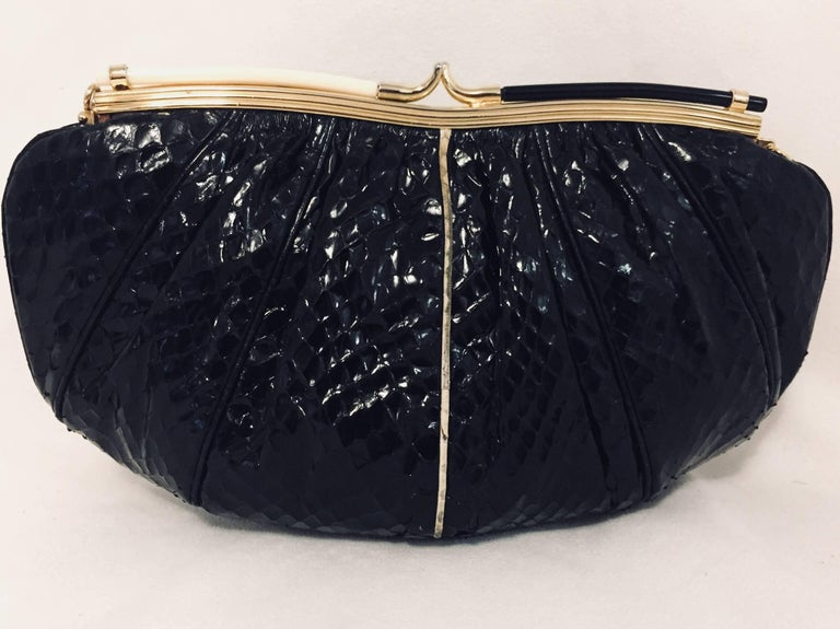 Vintage Black Evening Bag is highly desired by all collectors of Judith Leiber!  Featuring gold tone hardware and slightly gathered, butter-soft python allover, bag easily converts from clutch to shoulder bag using python strap with minimal effort!