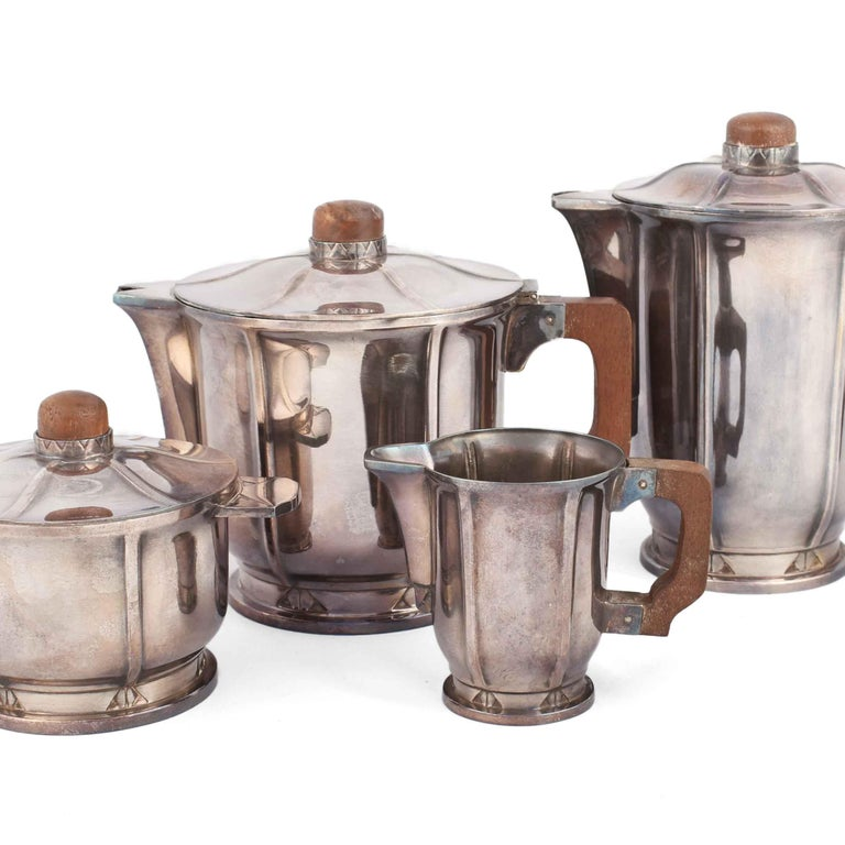Silver coffee set is an original decorative object realized between the 1920s and the 1930s.  Silver plate metal.  The mark