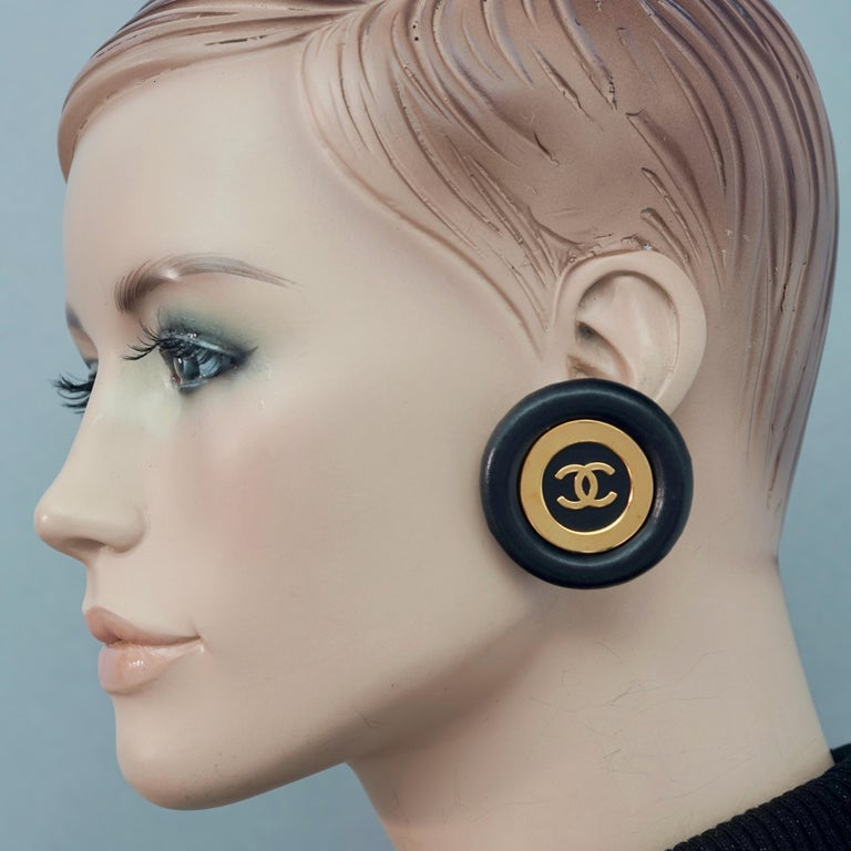 Vintage Jumbo CHANEL CC Logo Lambskin Leather Disc Earrings  Measurements: Height: 1.81 inches (4.6 cm) Width: 1.81 inches (4.6 cm) Weight per Earring: 21 grams  Features: - 100% Authentic CHANEL. - Jumbo black lambskin leather disc earrings. - CC