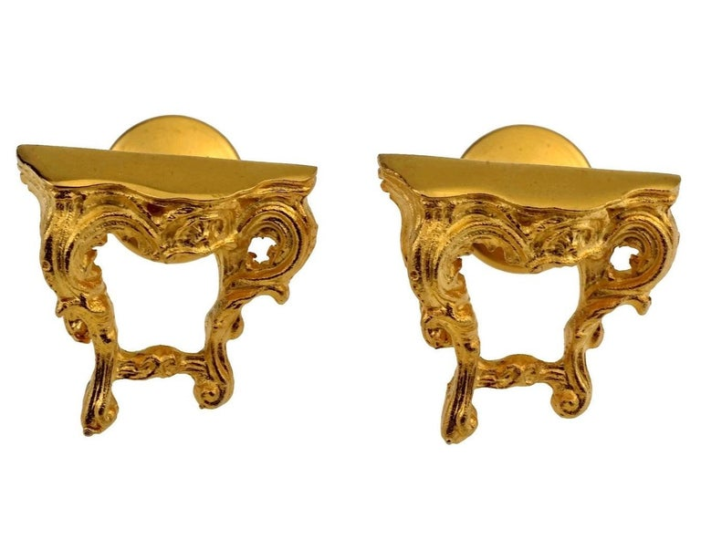 Vintage KARL LAGERFELD Baroque Table Cuff Links  Measurements: Height: 0.75 inch (1.9 cm) Width: 0.79 inch (2 cm) Depth: 0.94 inch (2.4 cm)  Features: - 100% Authentic KARL LAGERFELD. - Baroque style novelty table cuff links. - Matte gold tone