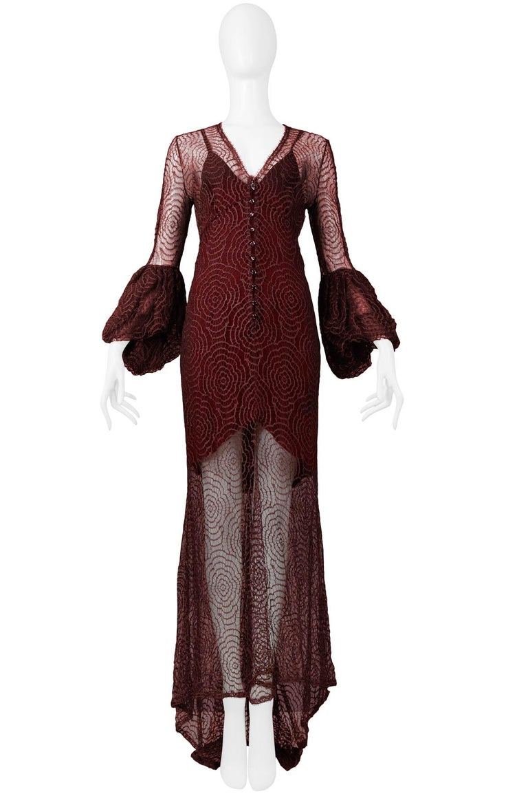 Vintage Karl Lagerfeld for Chloé burgundy abstract floral lace gown featuring, flounce sleeves, button front detail, slip underlay and an asymmetrical hem. From the 1994 Collection.   Excellent Condition.  Size: XS / S