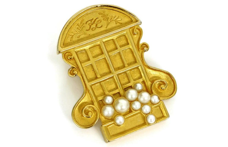 Vintage KARL LAGERFELD French Window Brooch  Measurements: Height: 1 3/4 inches Width: 1 3/8 inches   Features: - 100% Authentic KARL LAGERFELD. - Detailed French window embellished with Faux Pearls. - Matte gold hardware. - KL inscription on the