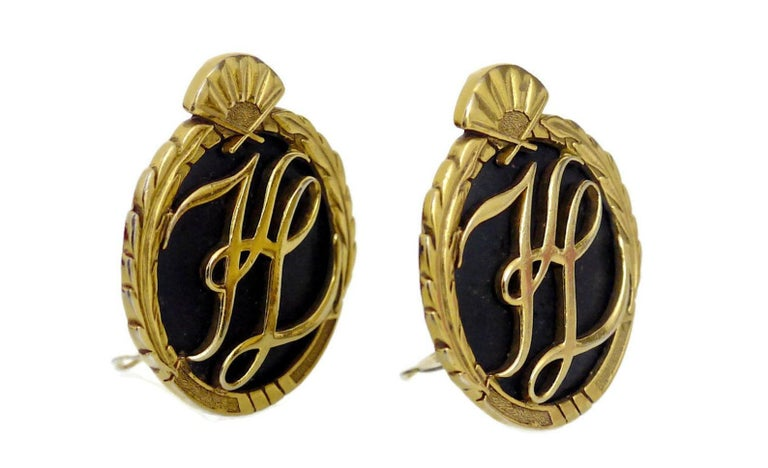 Vintage Karl Lagerfeld Iconic Logo Earrings  Measurements: Height: 1 6/8 inches Width: 1 5/8 inches  Features: - 100% Authentic KARL LAGERFELD. - Embossed KL initials at the center. - Ornate detailing at the sides and fan at the top. - Black
