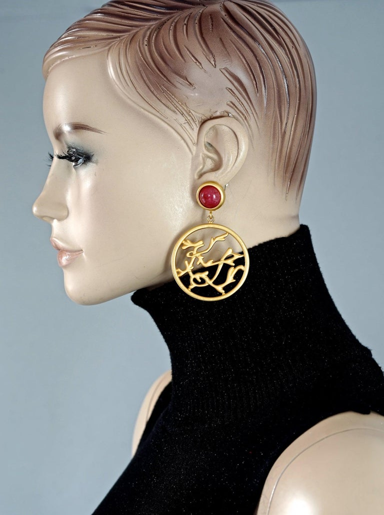 Vintage KARL LAGERFELD KL Logo Openwork Branch Hoop Earrings  Measurements: Height: 2.91 inches (7.4 cm) Width: 1.96 inches (5 cm) Weight per Earring: 27 grams  Features: - 100% Authentic KARL LAGERFELD. - Orange glass cabochon dangling hoop
