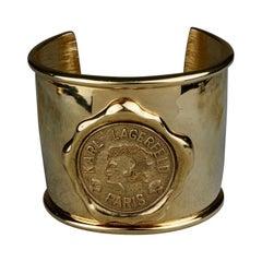 Vintage KARL LAGERFELD Logo Wax Seal Coin Medallion Cuff Bracelet