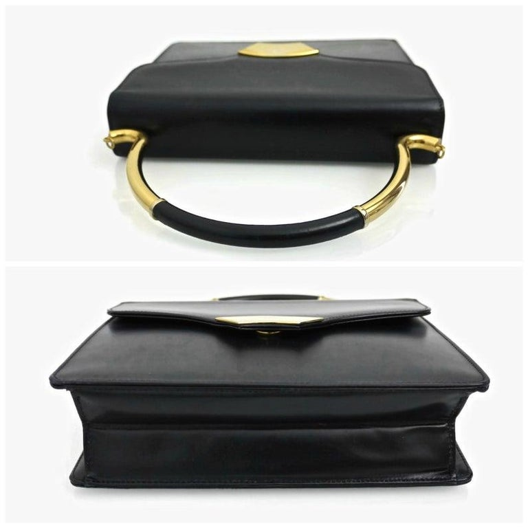 Vintage KARL LAGERFELD Navy Blue Kelly Bag  Measurements: Height: 11 inches (including handle) Height: 7 inches (without the handle) Width: 9 inches Depth: 2 6/8 inches  Features: - 100% Authentic KARL LAGERFELD. - Navy blue kelly bag. - Rigid top