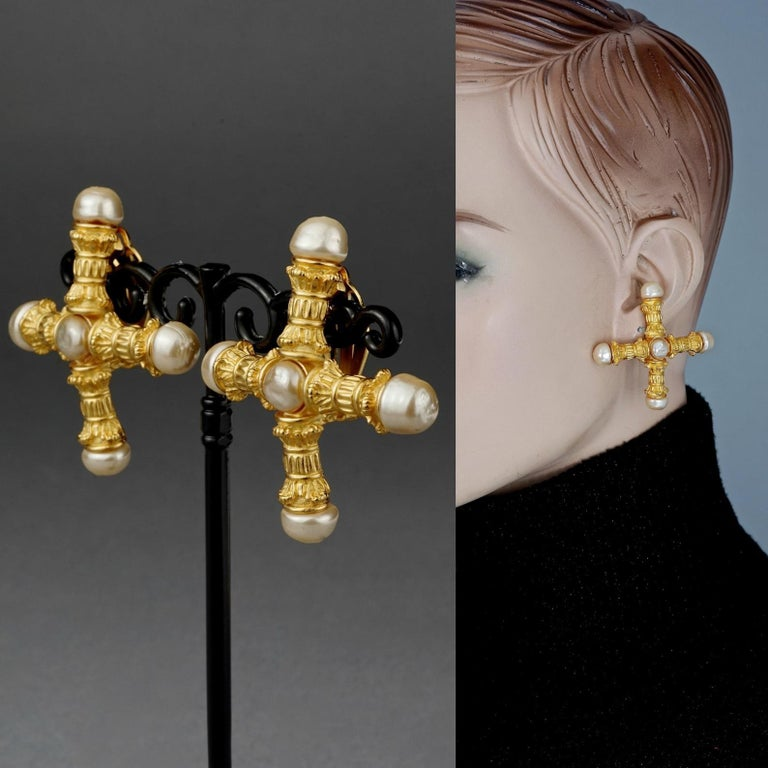 Vintage KARL LAGERFELD Roman Pillar Cross Pearl Earrings  Measurements: Height: 2 inches (5 cm) Width: 2 inches (5 cm) Weight: 19 grams  Features: - 100% Authentic KARL LAGERFELD. - Roman pillar motif in the form of cross. - Embellished with