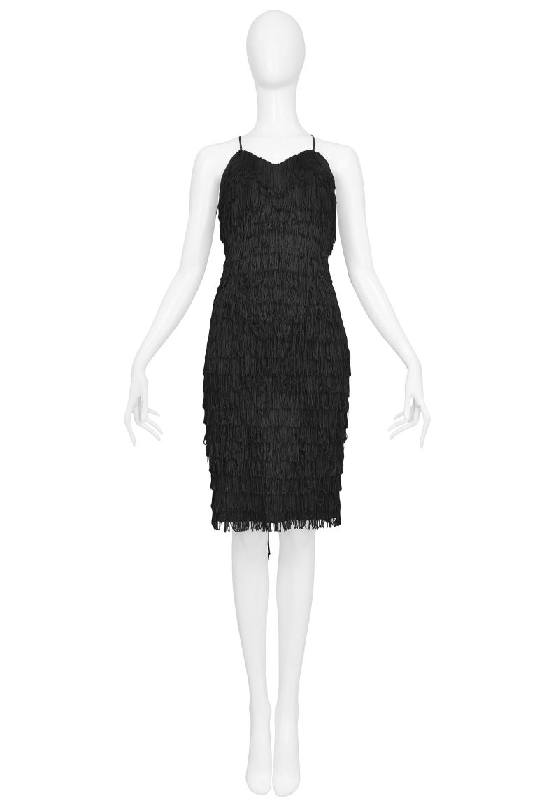 Vintage Katharine Hamnett black tiered fringe cocktail dress with sweetheart neckline, spaghetti straps, and lace-up back.  Excellent Vintage Condition.  Size: Small  Measurements: Bust: 32
