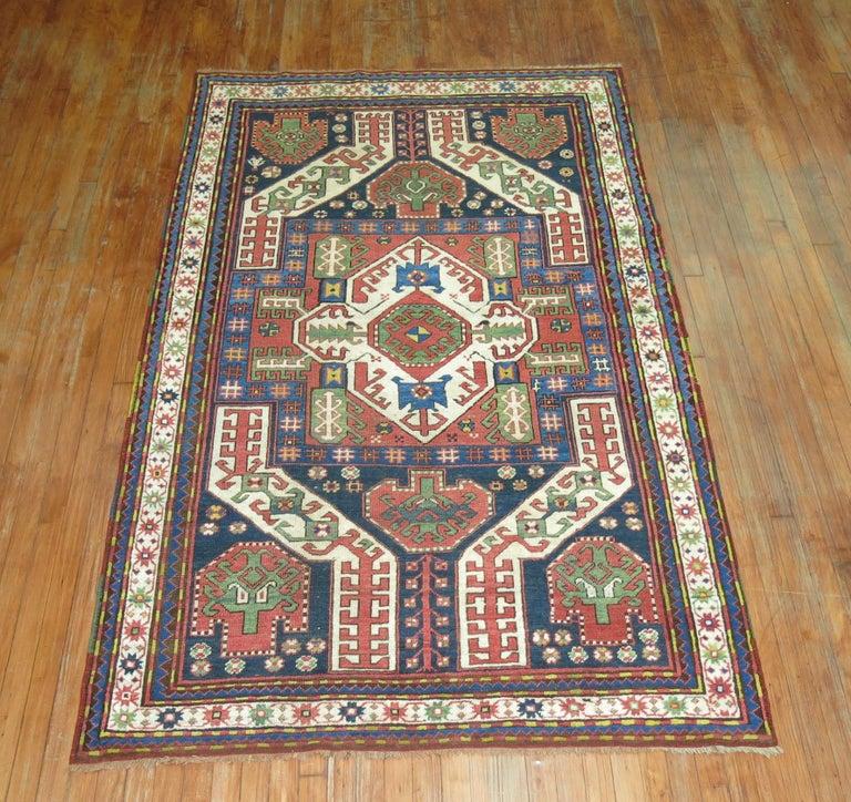 An authentic decorative vintage Kazak rug.