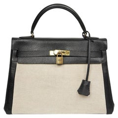 Vintage Kelly 32 HERMES in Beige Canvas and Black Leather