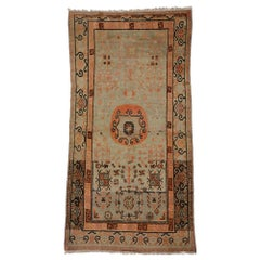 Vintage Khotan Rug with Suiyuan Xinjiang Design and Chinoiserie Chic Style