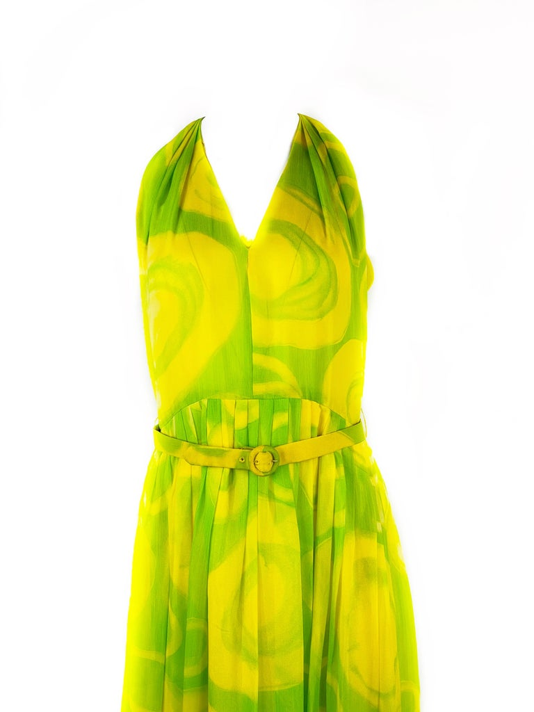 Product details: Yellow and green geometric, abstract, circle pattern Featuring v- neck cut out, and belt details Sleeveless  Floor length  Rear zip and two hooks closure Neiman Marcus Made in USA