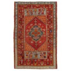 Vintage Kirsehir Traditional Red and Blue Wool Rug
