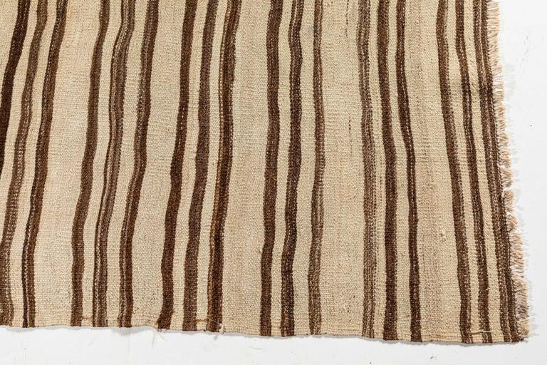 Vintage Konyan flat-weave rug with brown and natural stripes.