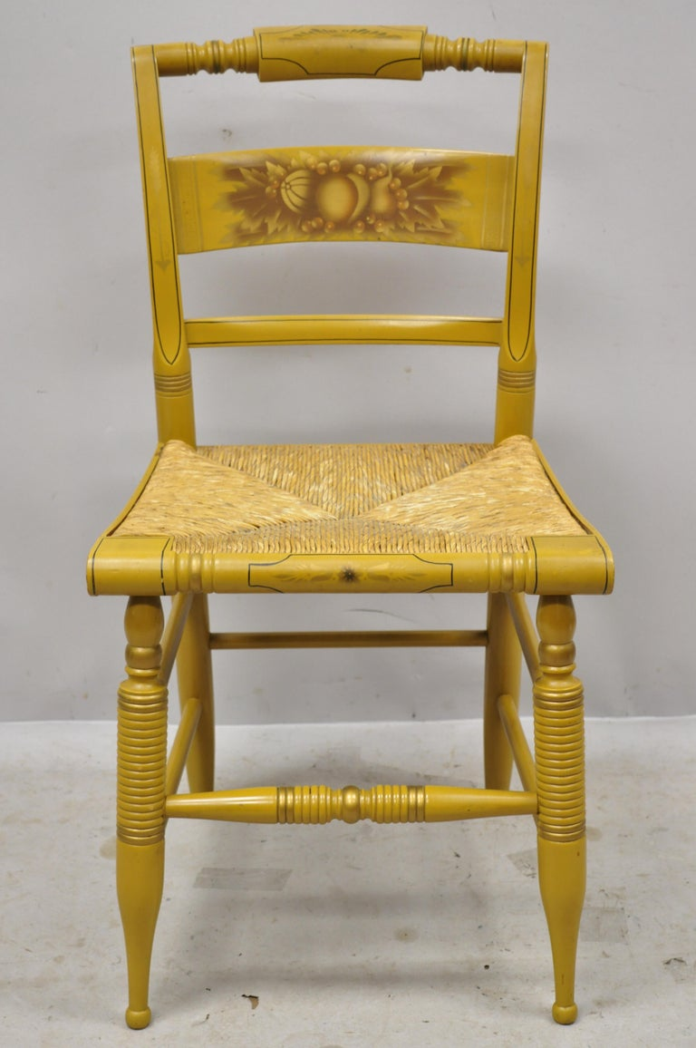 L. Hitchcock yellow stenciled rush seat dining side chair. Item features yellow stencil painted details, woven rush cord seat, solid wood construction, original signature, very nice vintage item, quality American craftsmanship, circa mid-20th