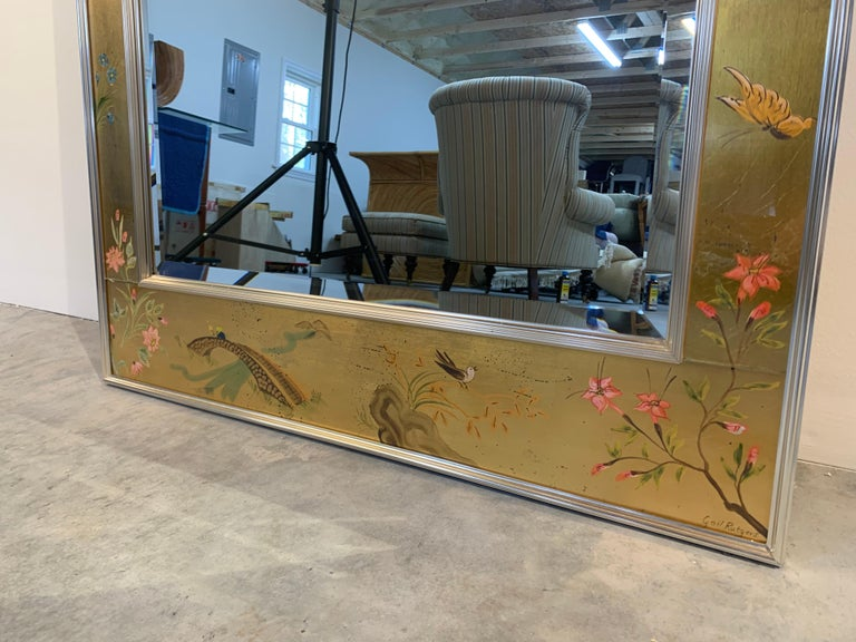 An exquisite Labarge Chinese/Asian chinoiserie style mirror. Outstanding quality, gold leaf overlay on reverse painted glass. The mirror is beveled.  Hand painted and signed by the artist 'Gail Rutgers', who we know was painting for Labarge, since