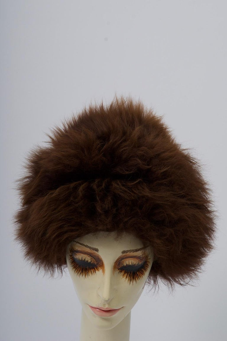 c.1960s lamb hat, constructed of two vertical skins and a cap of long-haired brown fur from Tuscany, Italy. Natural suede underside. Warm and stylish. approximate 22