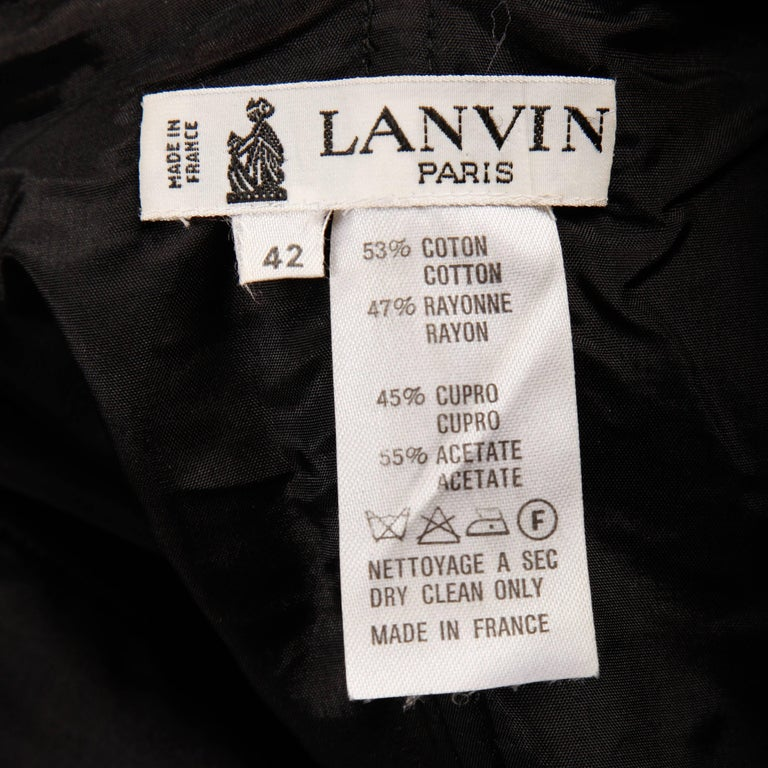 Vintage 1980s strapless moire dress by Lanvin with black velvet bows detail. Fully lined with side metal zip and hook closure. Hidden side pockets. 53% cotton, 47% rayon. The marked size is 42, but the dress fits like a modern size small. The bust