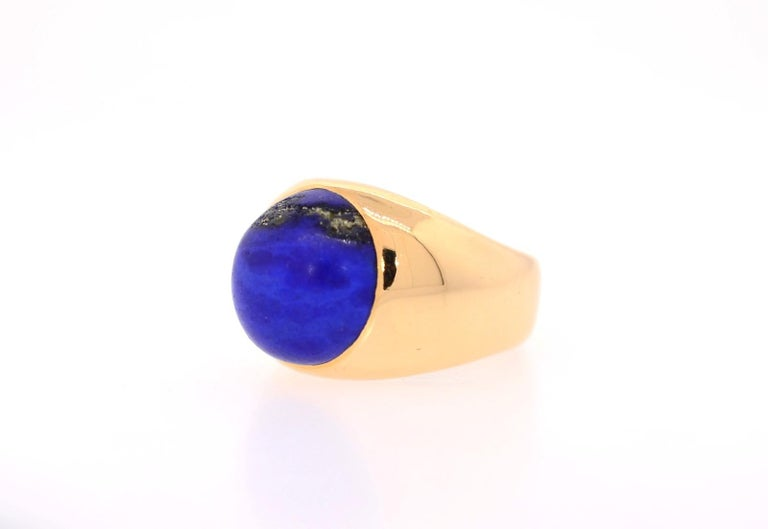 This hefty and well crafted Lapis Lazuli ring comes our way via the 1970s. The cabochon Lapis is bezel set in a comfortable-to-wear 18K yellow gold setting. A galaxy-like streak of Pyrite on the side lends a uniqueness to this solid and impressive