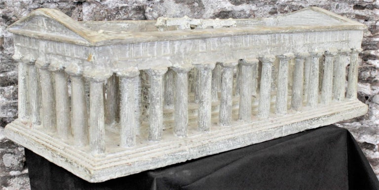 This large and substantial architectural model of an Ancient Greek temple is unsigned, but presumed to have been made in Italy in circa 1960 in a realistic style. This model or sculpture is composed of thick plaster built over a frame of wood and