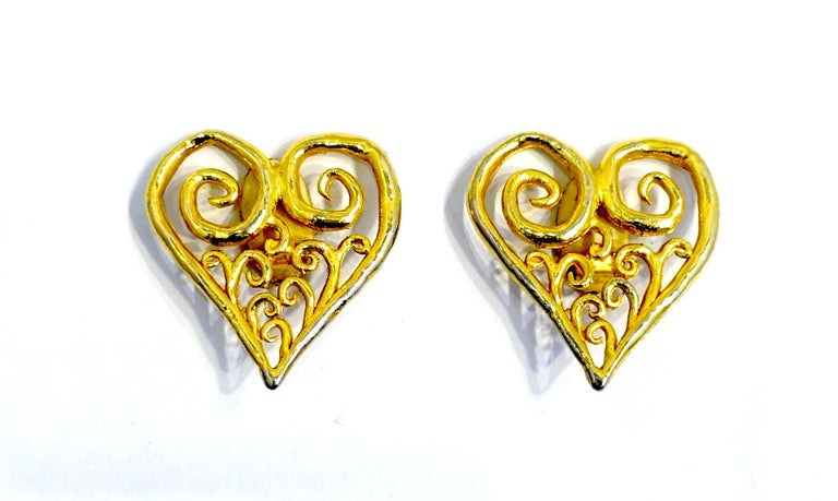 """These large vintage earrings have a heart in a curly cue open design in a gold tone setting.  These clip earrings measure 2"""" x 1-3/4"""" and are in excellent condition."""
