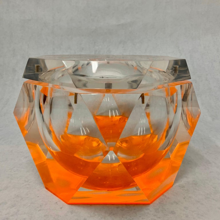 This oversized geometrically designed Italian ice bucket by Albrizzi with swing top is unique because of its orange hues which are enhanced by the sharp facets of the Lucite design. The jewelry style facets make this large chunky piece a must have!