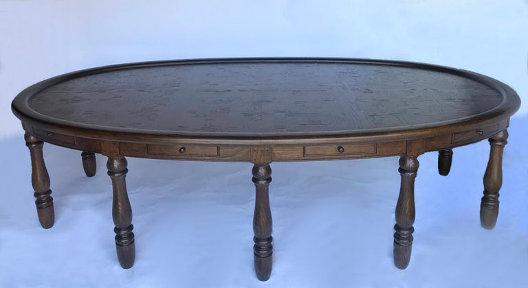 Vintage oval oak table with ten legs and ten drawers. Top has inlaid basketweave motif made from solid pieces of oak, not veneer. Recently finished in a durable finish, but still with a vintage feel. This would be an excellent conference table or