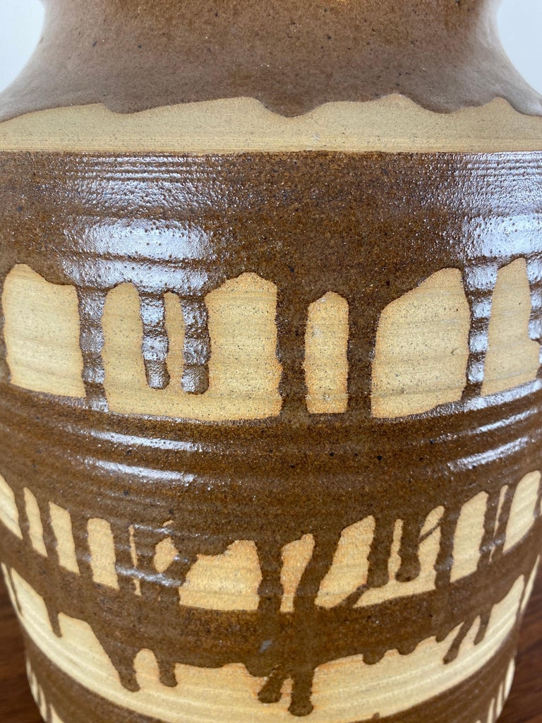 Vintage storage jar or decor crock. Cork lid with abstract striped glaze.  Free shipping.