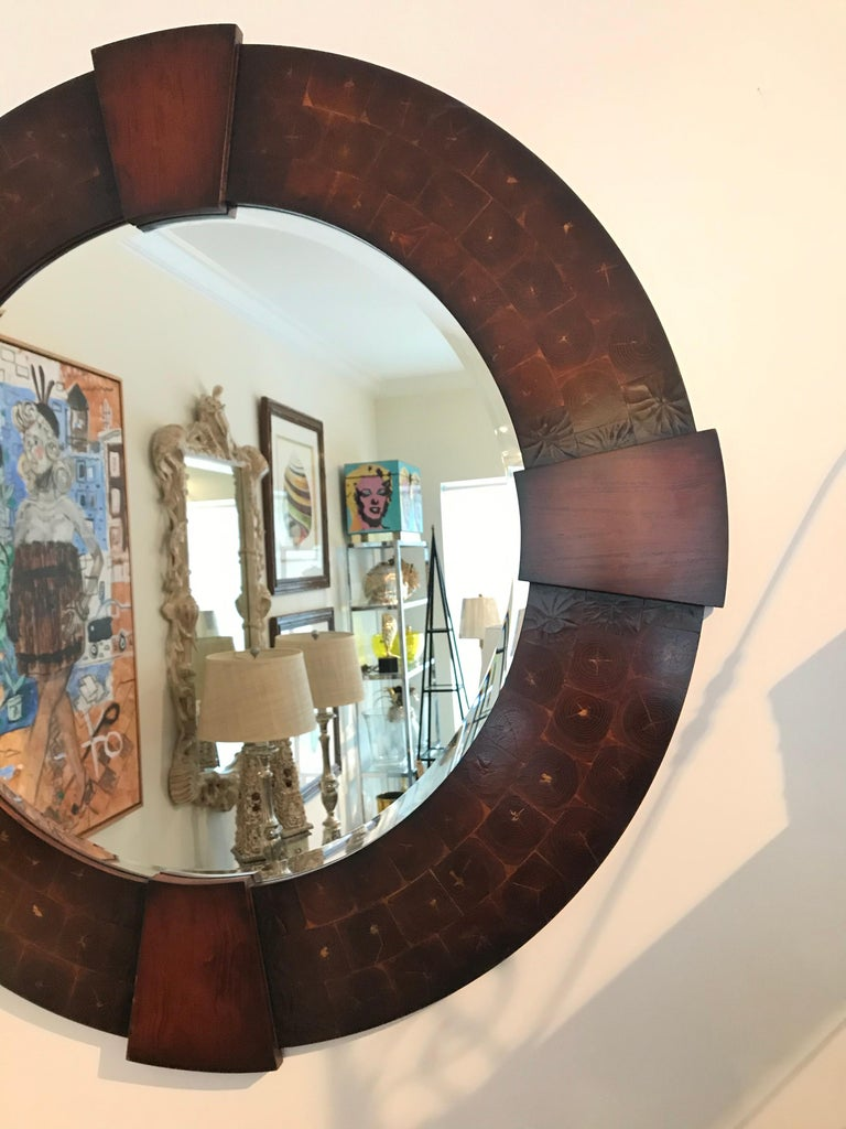Large round oyster wood mirror with four matching pediments.