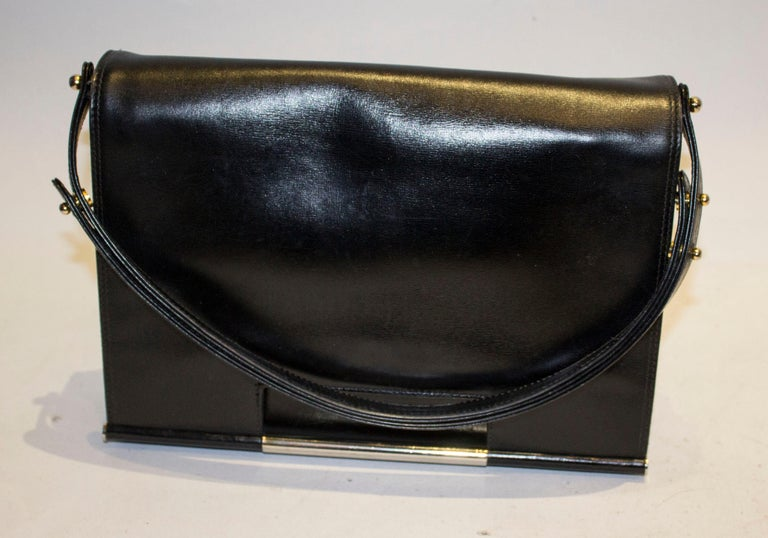 A chic vintage black leather bag by Launer. The bag has a flap over front with popper fastening and pouch pocket at the back. Internally there is a zip pocket in the lid ( like Chanel) and two compartments , one with a small pouch pocket.  The