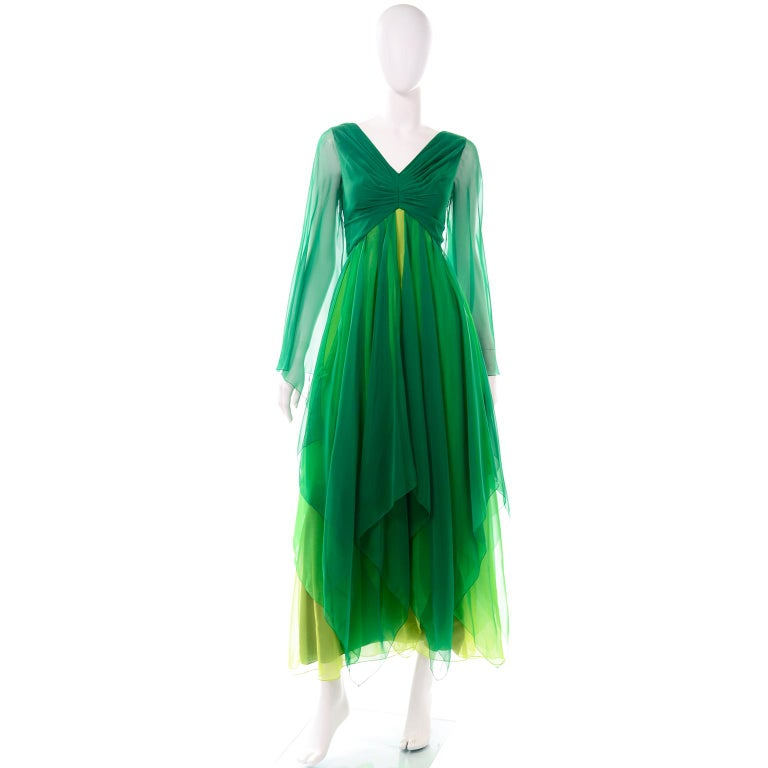 We love this amazing  green silk chiffon vintage dress! The layers of varying shades of green silk chiffon moves so effortlessly. We especially love the different lengths of the panels, which creates a handkerchief hemline. The dress looks so