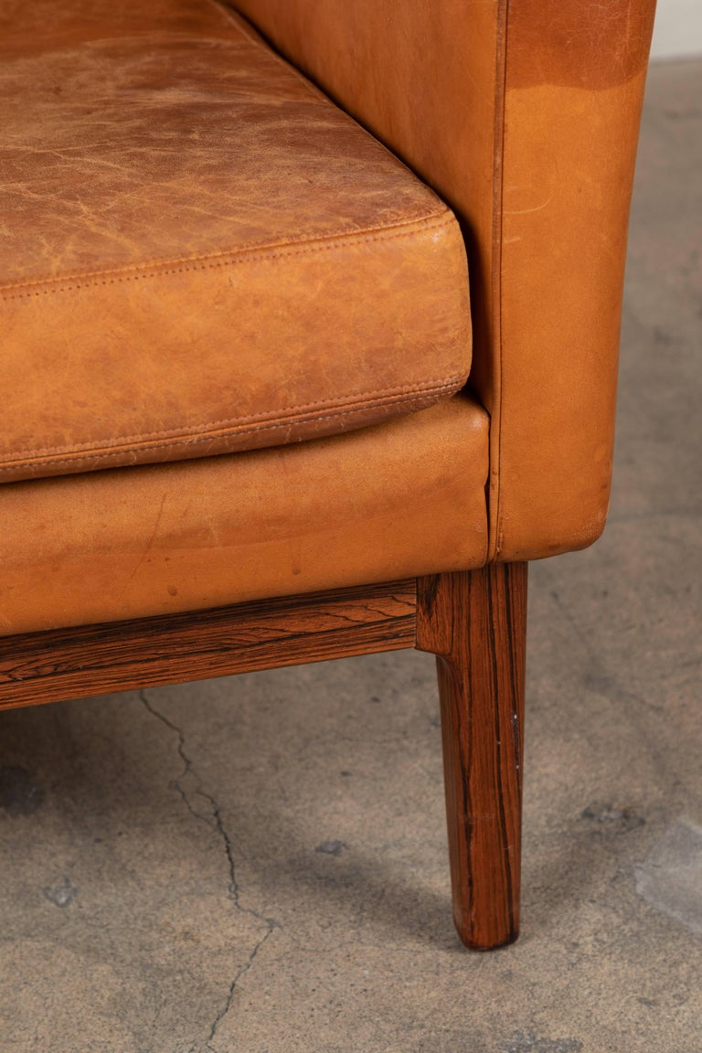 Mid-Century Modern Vintage Leather and Rosewood Chair by Arne Norell For Sale