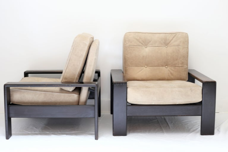Pair of vintage wood lounge chair. Newly upholstered in Moore & Giles Leather. Square button tufted cushions. FRN524.