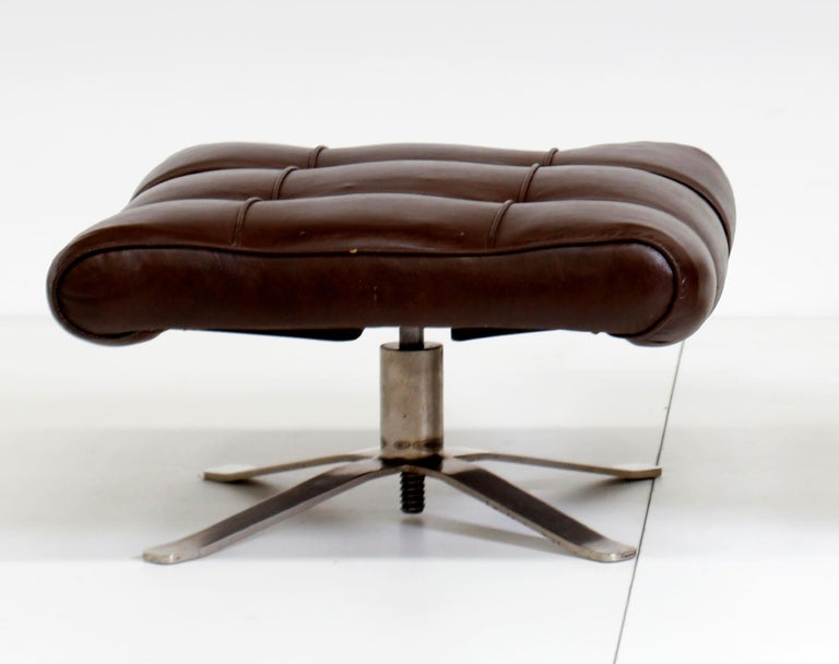 Vintage leather armchair with footrest is an original design work realized in Italy in the 1960s.  Original chrome-plated metal and Leather.  Made in Italy.  Total dimensions: cm 63 x 84 x 80.  Excellent conditions.