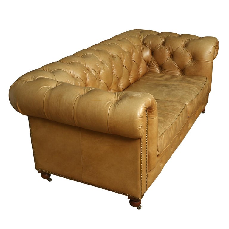 Vintage leather tufted Chesterfield loveseat.